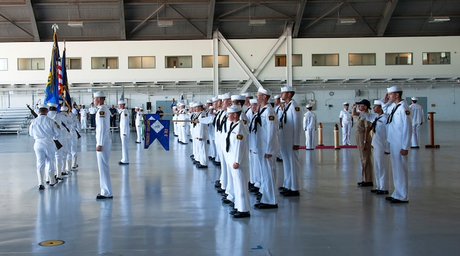 U.S. Naval Sea Cadet Corps (USNSCC) recruit training flight 1902 conducts a graduation ceremony, July 20, 2019, at MacDill Air Force Base, Fla. The USNSCC is a national youth leadership development organization that promotes interest in naval disciplines and is modeled after the Navy's professional development system. (U.S. Air Force photo by Airman 1st Class Shannon Bowman)