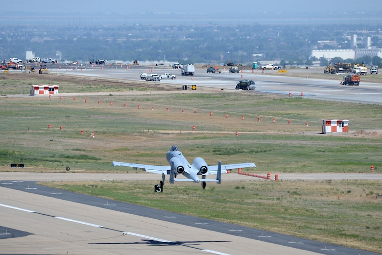Runway construction efforts can be seen from the control tower as Col. James Doyle, 413th Flight Test Group test pilot, takes off to the north from taxiway Alpha in an A-10 Thunderbolt II at Hill Air Force Base, Utah, July 10, 2019. The runway at Hill AFB was closed for most of the summer, requiring test pilots from the 514th to temporarily use the taxiway as a runway. (U.S. Air Force photo by Alex R. Lloyd)