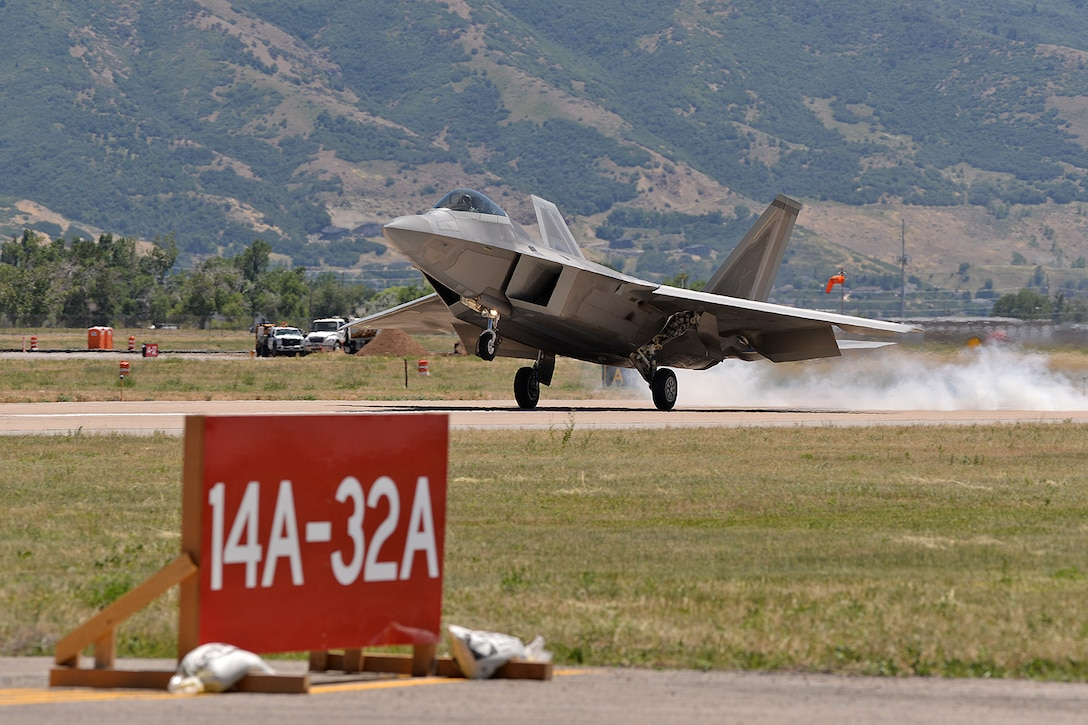 Maj. Philip Johnson, 514th Flight Test Squadron test pilot, smokes the tires upon touching down on taxiway Alpha in an F-22 Raptor after a functional check flight at Hill Air Force Base, Utah, July 1, 2019.  The runway at Hill AFB was closed for most of the summer, requiring test pilots from the 514th to temporarily use the taxiway as a runway. (U.S. Air Force photo by Alex R. Lloyd)