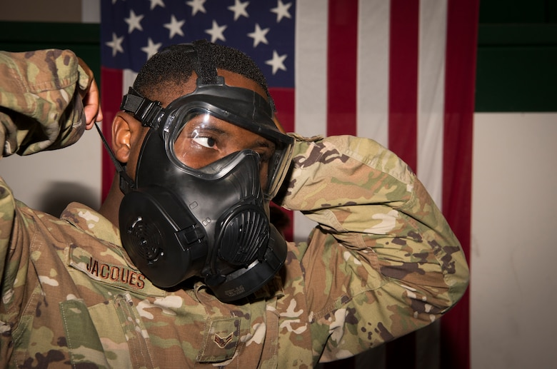 Airman 1st Class Kerson Jacques, a 6th Communications Squadron radio transmission systems technician, puts on a gas mask during deployment readiness training at MacDill Air Force Base, Fla., July 25, 2019.