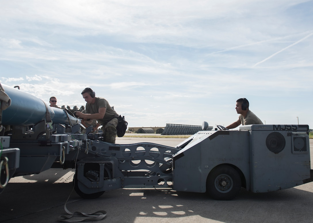 Staff Sgt. Timothy Chouinard, 391st Fighter Squadron, weapopns load crew chief, and Senior Airman Jonathan Castelan Medina, 391st FS, weapons load crew chief, prepare to load training equipment into an F-15E Strike Eagle during the Adaptive Basing exercise July 17, 2019, at Mountain Home Air Force Base. This training was done in order for the fighter squadrons to sharpen their Adaptive Basing strategies, enhancing it's potential down range. (U.S. Air Force photo by Senior Airman Tyrell Hall)