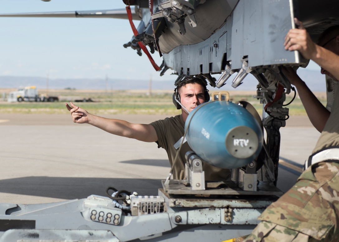 Staff Sgt. Timothy Chouinard, 391st Fighter Squadron, weapopns load crew chief, directs a loading process for an F-15E Strike Eagleduring the Adaptive Basing exercise July 17, 2019, at Mountain Home Air Force Base. This training was done in order for the fighter squadrons to sharpen their Adaptive Basing strategies, enhancing it's potential down range. (U.S. Air Force photo by Senior Airman Tyrell Hall)