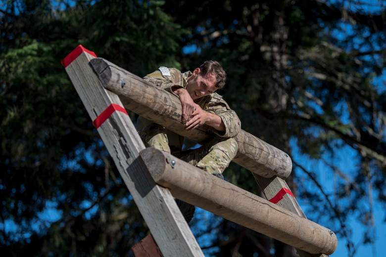 A U.S. Air Force Tactical Air Control Party Airman assigned to the 5th Air Support Operations Squadron, Joint Base Lewis-McChord (JBLM), Wash., climbs on top of an obstacle during the 2019 Lightning Challenge at JBLM, Wash., July 29, 2019.