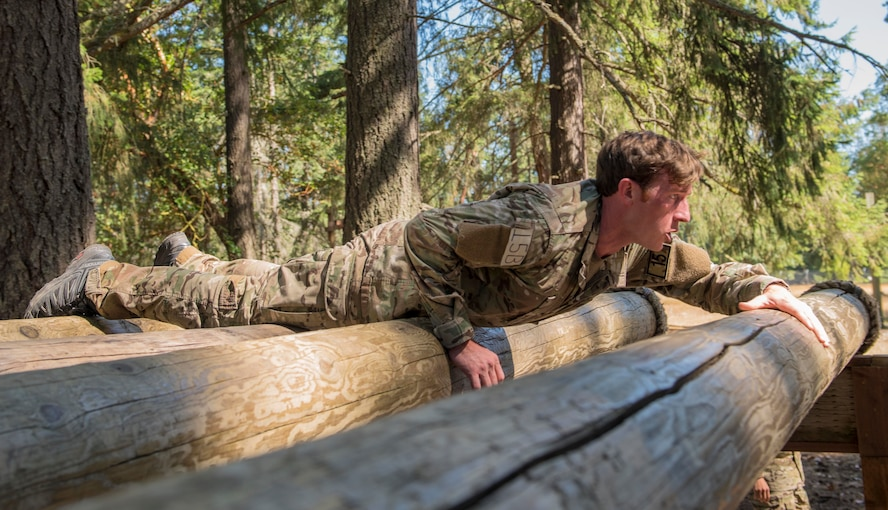 A U.S. Air Force Tactical Air Control Party (TACP) Airman assigned to the 116th Air Support Operations Squadron, Camp Murray, Wash., crawls across rolling logs during the 2019 Lightning Challenge at Joint Base Lewis-McChord, Wash., July 29, 2019.