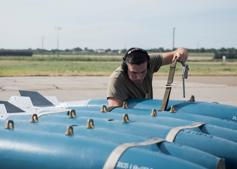 Staff Sgt. Timothy Chouinard, 391st Fighter Squadron, weapopns load crew chief, directs a load of training equipment into an F-15E Strike Eagle during the Adaptive Basing exercise July 17, 2019 at Mountain Home Air Force Base. This training was done in order for the fighter squadrons to sharpen their Adaptive Basing strategies, enhancing it's potential down range. (U.S. Air Force photo by Senior Airman Tyrell Hall)