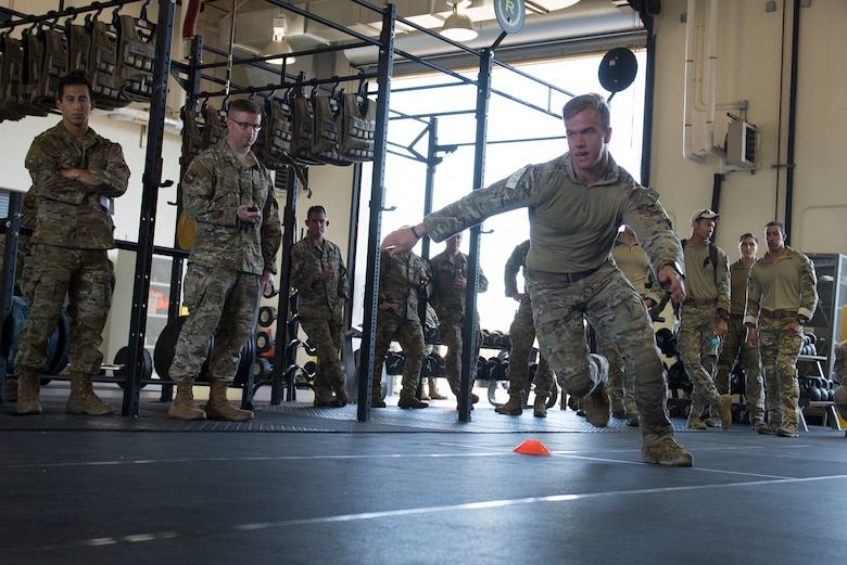 A U.S. Air Force Tactical Air Control Party (TACP) Airman assigned to the 9th Air Support Operations Squadron, Ford Hood, Texas, performs a timed two-cone drill as part of a Tier II Operator Fitness Test during the 2019 Lightning Challenge at Joint Base Lewis-McChord, Wash., July 29, 2019.