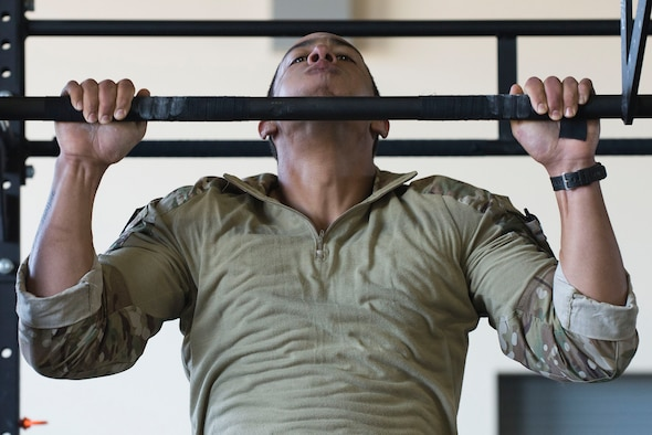 A U.S. Air Force Tactical Air Control Party Airman assigned to the 10th Air Support Operations Squadron, Fort Riley, Kansas, performs pull-ups as part of a Tier II Operator Fitness Test during the 2019 Lightning Challenge at Joint Base Lewis-McChord, Wash., July 29, 2019.