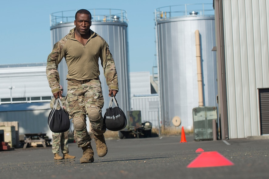 A U.S. Air Force Tactical Air Control Party (TACP) Airman assigned to the 7th Air Support Operations Squadron, Fort Bliss, Texas, runs while carrying weighted bags as part of a Tier II Operator Fitness Test during the 2019 Lightning Challenge at Joint Base Lewis-McChord, Wash., July 29, 2019.