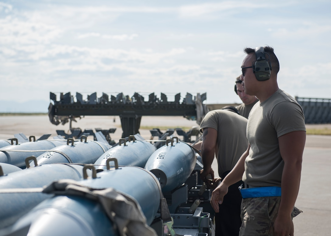 Weapons load crew chiefs from the 391st Fighter squadron prepare to load training eqipment onto an F-15E Strike Eagle during the Adaptive Basing exercise July 17, 2019 at Mountain Home Air Force Base. Weapons load crew chiefs play a vital role in down-range missions, as they are charged with making sure fighter aircraft are re-armed efficiently to continue the fight. (U.S. Air Force photo by Senior Airman Tyrell Hall)