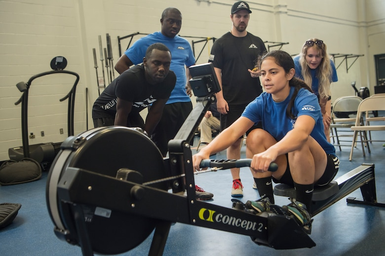 U.S. Air Force 1st Lt. Tiffany Hatcher, United States Special Operations Command Detachment-1, Special Operations Forces AC-130 branch chief, Eglin Air Force Base, Fla., performs exercises on a rowing machine during the Alpha Warrior Super Regional event July 27, 2019, at Joint Base Charleston, S.C. Twelve Airmen competed, tackling a variety of functional fitness obstacles, while utilizing the Joint Base Charleston Fitness Center's Alpha Warrior battle rig. The competition focuses on a competitor's overall readiness and is designed to promote more fit and resilient service members.