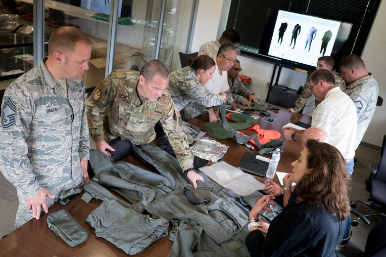 Aircrew Flight Equipment Airmen from the 154th and 15th Operations Support Squadrons examine the latest installments of equipment July 8, 2019 at Joint Base Pearl Harbor-Hickam, Hawaii.