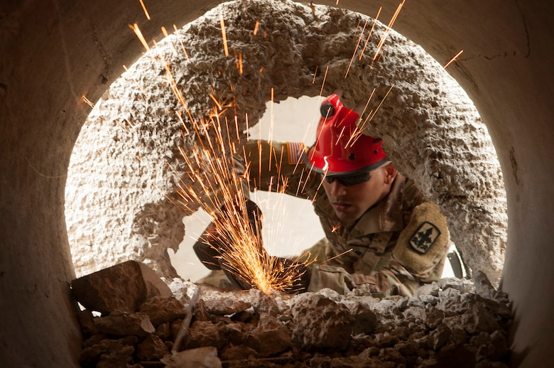 Hawaii Army National Guard Spc. Tyson Ortiz breaks through concrete and reinforced steel as part of the Combined - Multinational Task Force (CTF 501) search and extraction training scenario on July 18, 2019 at Kalaeloa Urban Search and Rescue Training area, Hawaii.