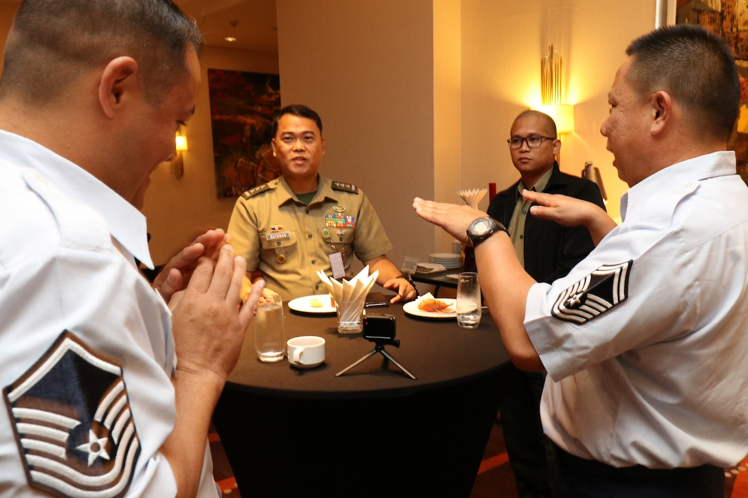 Hawaii Air National Guard Senior Master Sgt. Michael Zheng, Intelligence Analyst from the 201st Intelligence Squadron, shares some disaster response experiences with Philippine Army Capt. Rene Datugan, during an Incident Awareness and Assessment (IAA) Subject Matter Expert Exchange (SMEE) conference in Makati on July 16, 2019.