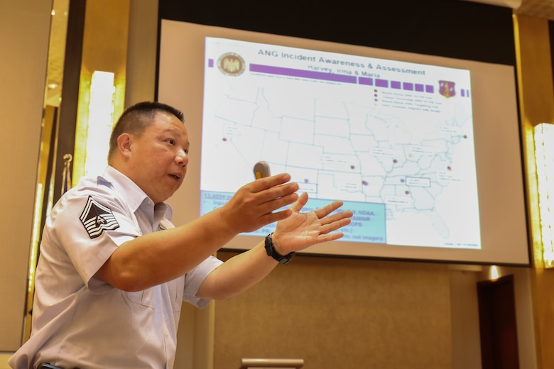 Hawaii Air National Guard Senior Master Sgt. Michael Zheng, Intelligence Analyst from the 201st Intelligence Squadron, presents operational knowledge with their counterparts in the Armed Forces of the Philippines during an Incident Awareness and Assessment (IAA) Subject Matter Expert Exchange (SMEE) conference in Makati on July 16, 2019