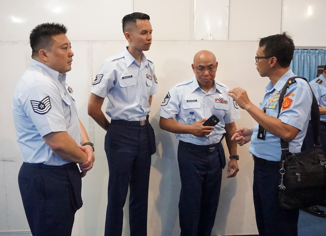 Hawaii Air National Guard (HIANG) members from the 169th Air Defense Squadron (ADS) talk with a member of the Indonesian Air Force (TNI) Jul. 10, 2019 in Yogyakarta, Indonesia.