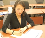 Female employee reading a briefing and taking notes