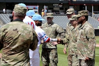 Army Reserve Soldiers assigned to the 85th U.S. Army Reserve Support Command headquarters meet players from the American Association of Independent Professional Baseball's Chicago Dogs baseball team, July 28, 2019, at Impact Field in Rosemont, Illinois during a home game there against the Cleburne Railroaders.