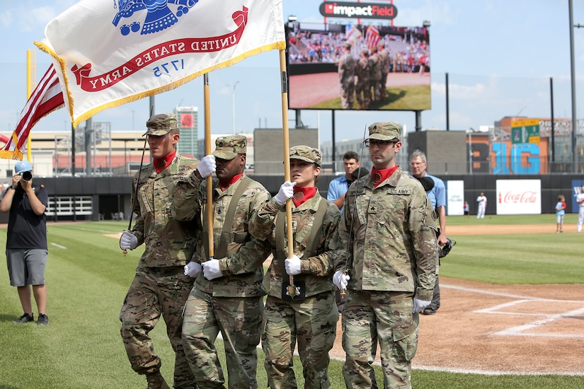 An Army Reserve color guard team, assigned to the 85th U.S. Army Reserve Support Command headquarters, present the Nation's Colors during the American Association of Independent Professional Baseball's Chicago Dogs baseball home game, July 28, 2019, at Impact Field in Rosemont, Illinois against the Cleburne Railroaders.