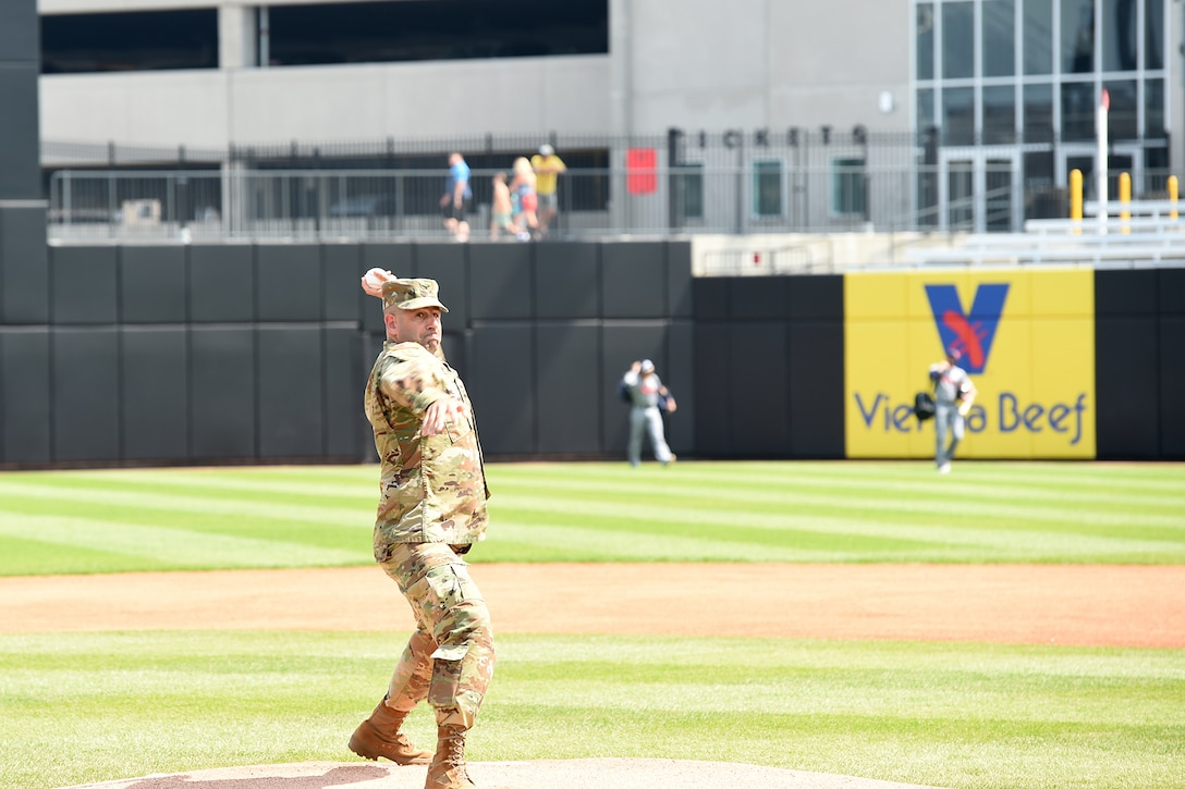 Army Reserve Col. Daniel Jaquint, assigned to the 85th U.S. Army Reserve Support Command headquarters, throws out a first pitch during the American Association of Independent Professional Baseball's Chicago Dogs baseball home game, July 28, 2019, at Impact Field in Rosemont, Illinois against the Cleburne Railroaders.