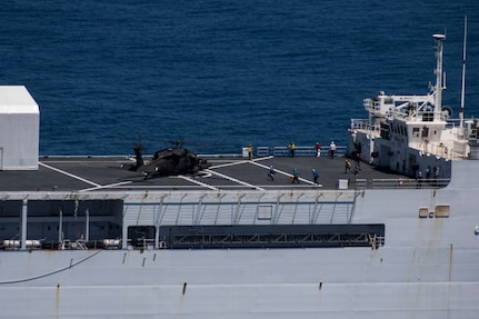 A UH-60 Blackhawk assigned to the 1st Battalion 228th Aviation Regiment lands on to U.S. Naval Ship Comfort during deck landing qualifications July 20, 2019, off the coast of Punta Arenas Costa Rica. U.S. Army Helicopter pilots and crew members of Joint Task Force –Bravo completed qualifications July 18-26 to support an upcoming mission, off the coast of Punta Arenas, Costa Rica. (U.S. Air Force photo by Staff Sgt. Eric Summers Jr.)