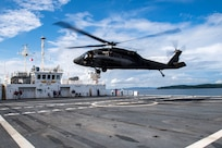 A UH-60 Blackhawk assigned to the 1st Battalion 228th Aviation Regiment completes a bounce off the U.S. Naval Ship Comfort during deck landing qualifications July 26, 2019, off the coast of Punta Arenas Costa Rica. U.S. Army Helicopter pilots and crew members of Joint Task Force –Bravo completed qualifications July 18-26 to support an upcoming mission, off the coast of Punta Arenas, Costa Rica (U.S. Air Force photo by Staff Sgt. Eric Summers Jr.)