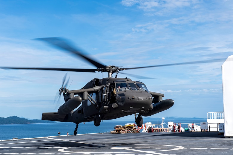 A UH-60 Blackhawk assigned to the 1st Battalion 228th Aviation Regiment completes a bounce off the U.S. Naval Ship Comfort during deck landing qualifications July 26, 2019, off the coast of Punta Arenas Costa Rica. U.S. Army Helicopter pilots and crew members of Joint Task Force –Bravo completed qualifications July 18-26 to support an upcoming mission, off the coast of Punta Arenas, Costa Rica. (U.S. Air Force photo by Staff Sgt. Eric Summers Jr.)