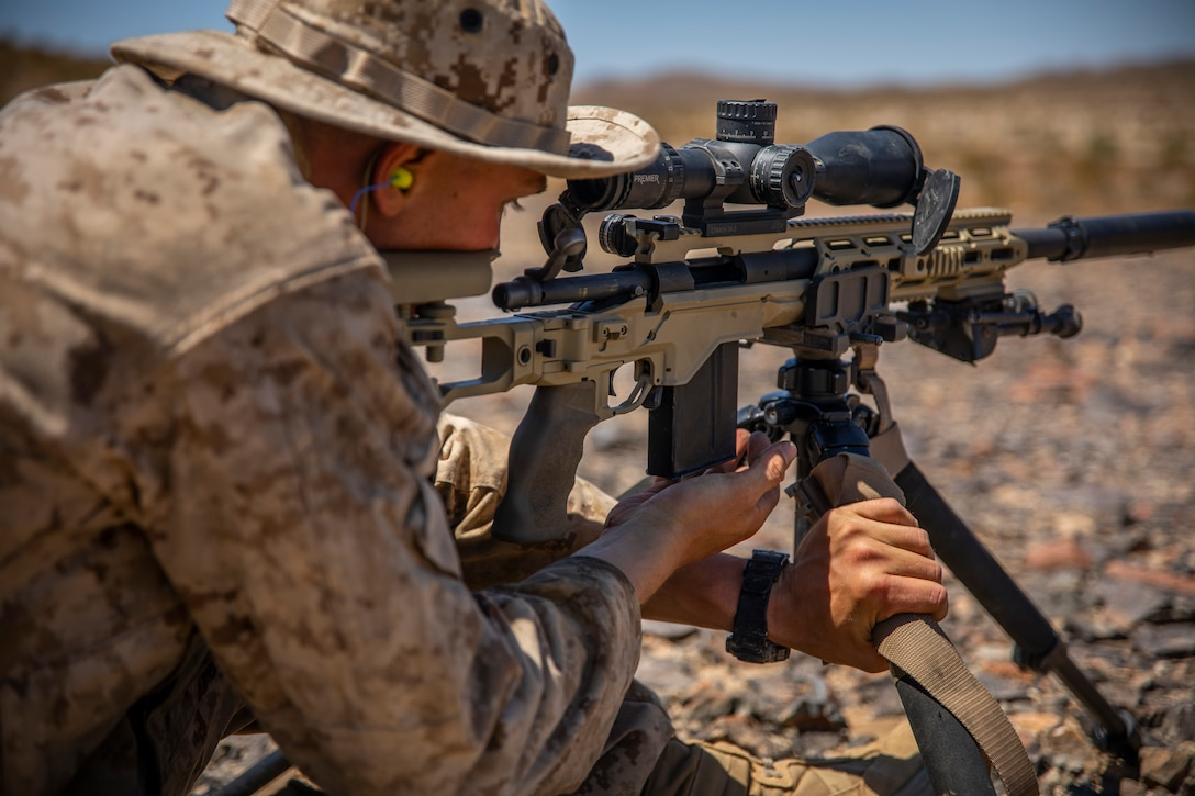 A U.S. Marine with Scout Sniper Platoon, 1st Battalion, 25th Marine Regiment, 4th Marine Division, fires a M40A6 Sniper Rifle at Marine Corps Air Ground Combat Center Twentynine Palms, Calif., July 27, 2019, during Integrated Training Exercise 5-19. After ITX 5-19, 1st Battalion, 25th Marine Regiment will be activated and deploy to the Indo-Pacific Command to conduct multiple exercises across the region. ITX measures the unit's ability to provide a cohesive, trained, and ready capability in support of service and Combatant Commander requirements. (U.S. Marine Corps photo by Sgt. Andy O. Martinez)