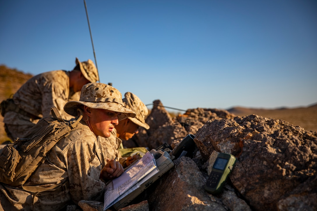 U.S. Marines with Scout Sniper Platoon, 1st Battalion, 25th Marine Regiment, 4th Marine Division, conduct call-for-fire drills at Marine Corps Air Ground Combat Center Twentynine Palms, Calif., July 27, 2019, during Integrated Training Exercise 5-19. After ITX 5-19, 1st Battalion, 25th Marine Regiment will be activated and deploy to the Indo-Pacific Command to conduct multiple exercises across the region. ITX measures the unit's ability to provide a cohesive, trained, and ready capability in support of service and Combatant Commander requirements. (U.S. Marine Corps photo by Sgt. Andy O. Martinez)