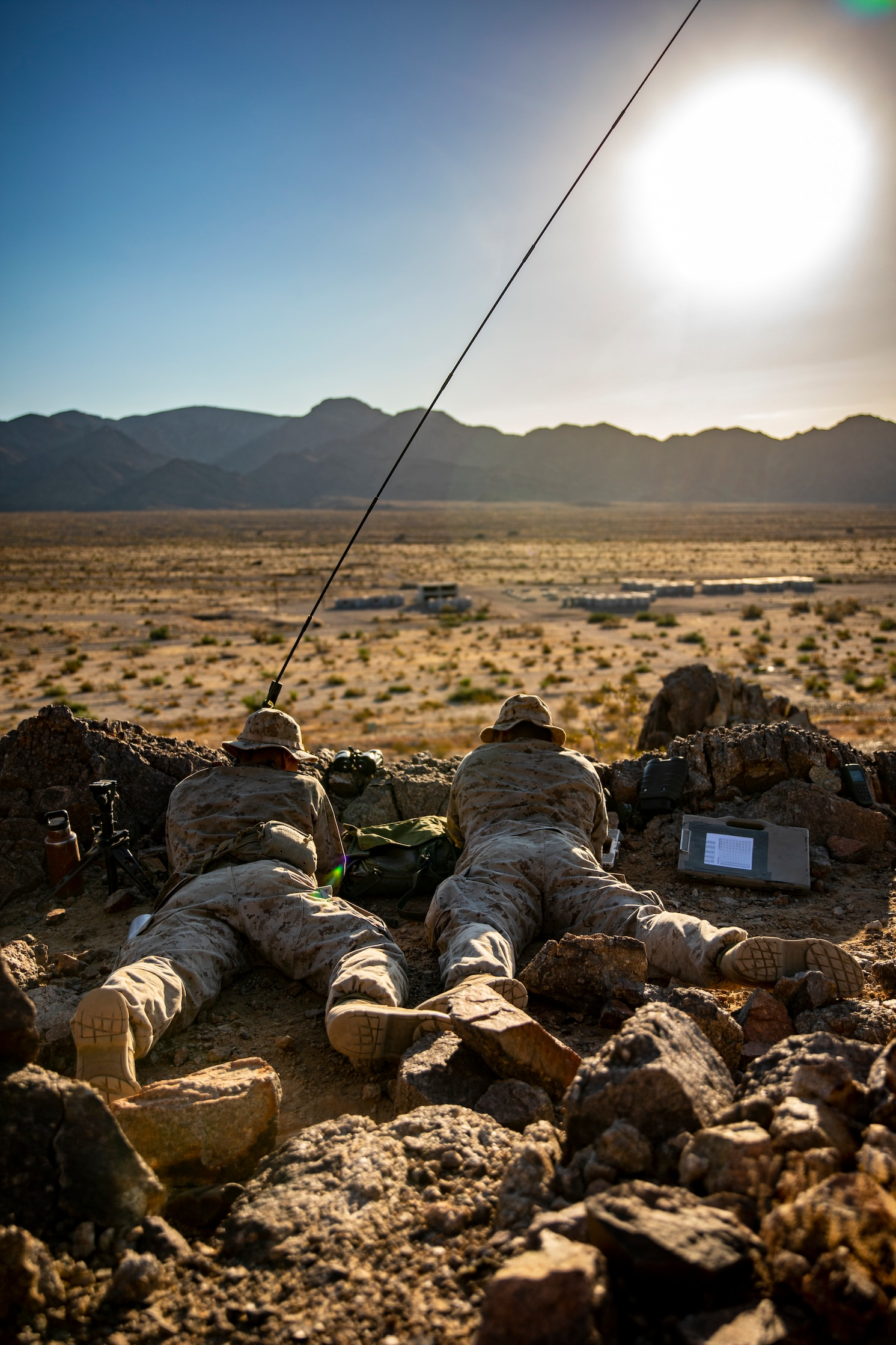 U.S. Marines with Scout Sniper Platoon, 1st Battalion, 25th Marine Regiment, 4th Marine Division, call in coordinates for a call-for-fire drill at Marine Corps Air Ground Combat Center Twentynine Palms, Calif., July 27, 2019, during Integrated Training Exercise 5-19. After ITX 5-19, 1st Battalion, 25th Marine Regiment will be activated and deploy to the Indo-Pacific Command to conduct multiple exercises across the region. ITX measures the unit's ability to provide a cohesive, trained, and ready capability in support of service and Combatant Commander requirements. (U.S. Marine Corps photo by Sgt. Andy O. Martinez)
