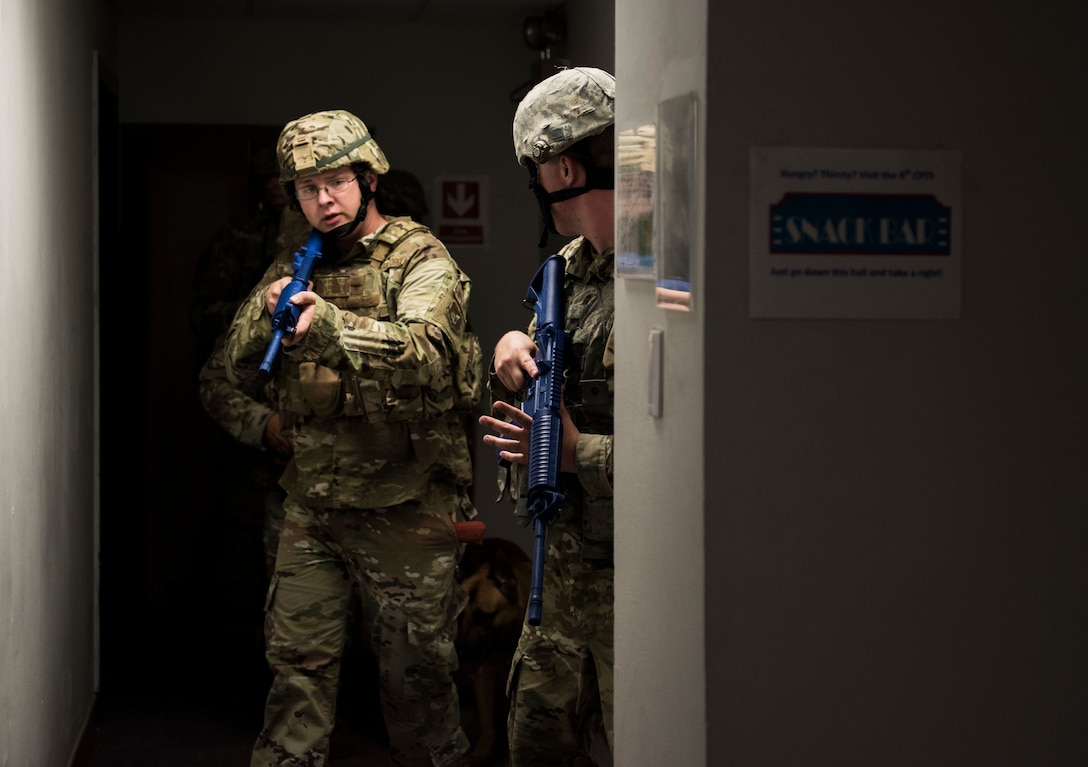 Members of the 8th Security Forces Squadron clear a building during an exercise at Kunsan Air Base, Republic of Korea, July 23, 2019. 8th SFS routinely trains to respond to a variety of threats. (U.S. Air Force photo by Senior Airman Stefan Alvarez)