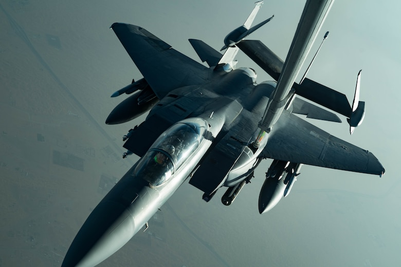 An F-15E Strike Eagle assigned to the 336th Expeditionary Fighter Squadron refuels from a KC-10 Extender June 27, 2019, at an undisclosed location during a surface combat air patrol mission. The F-15Es are currently supporting SuCAP missions for maritime transportation in the Arabian Gulf. (U.S. Air Force photo by Staff Sgt. Erin Piazza)