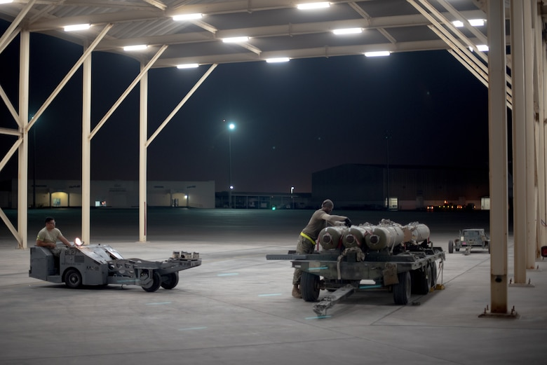 An F-15E Strike Eagle weapons load crew team prepares munitions July 15, 2019, at Al Dhafra Air Base, United Arab Emirates. The F-15E has the capability to carry any air-to surface weapon in the Air Force inventory. (U.S. Air Force photo by Staff Sgt. Chris Thornbury)