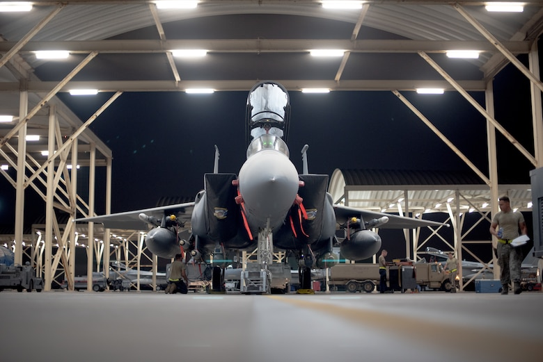 An F-15E Strike Eagle  sits while waiting for an upcoming mission July 15, 2019, at Al Dhafra Air Base, United Arab Emirates. The F-15E is a dual-role fighter designed to perform air-to-air and air-to-ground missions and is currently supporting surface combat air patrol operations in the Arabian Gulf. (U.S. Air Force photo by Staff Sgt. Chris Thornbury)