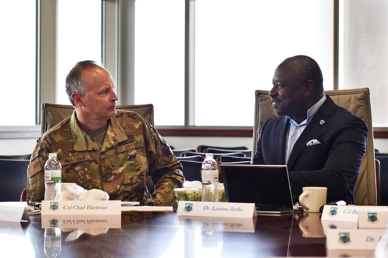 CTBTO Preparatory Commission Executive Secretary Dr. Lassina Zerbo (right) meets with Air Force Technical Applications Center Commander Col. Chad Hartman at Patrick AFB, Fla., July 25, 2019 to discuss the collaborative partnership the two organizations have been able to capitalize on by employing emerging technologies and breakthroughs in nuclear monitoring innovations.  (U.S. Air Force photo by Matthew S. Jurgens)