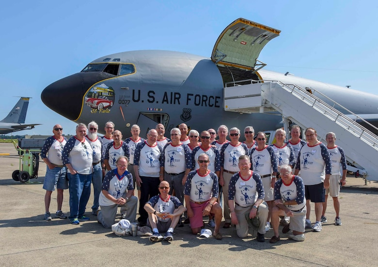 Group of Vietnam veterans pose for a photo in front of a KC-135 aircraft.