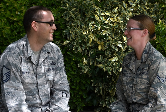 U.S. Air Force Master Sgt. Stuart Witkop, left, 34th Intelligence Squadron supervisor, and Airman1st Class Mary Witkop, 70th Operations Support Squadron technician, pose for a photo at Fort George G. Meade, Maryland, June 19, 2019,. Mary was a Key Spouse for the 34th IS for four years before enlisting in September 2018. (U.S. Air Force photo by Senior Airman Gerald R. Willis)