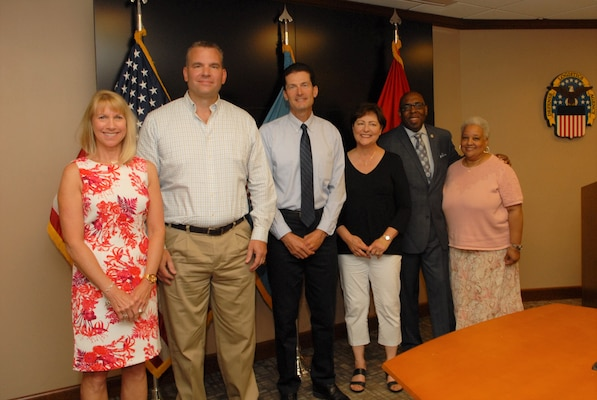Defense Logistics Agency employees celebrate their retirement after more than 30 years.