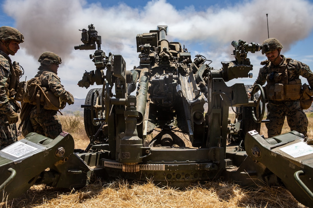 U.S. Marines with Fox Battery, 2nd Battalion, 11th Marine Regiment, 1st Marine Division, fire an M777 howitzer during Summer Fire Exercise 19 at 62 Area on Marine Corps Base Camp Pendleton, California, July 23, 2019. The Marines are conducting Summer FIREX, a live-fire regimental-level exercise, from July 22 to Aug. 1. The exercise is designed to bring the entire regiment together and maximize the training areas available on Camp Pendleton to enhance their ability to conduct real-world operations.