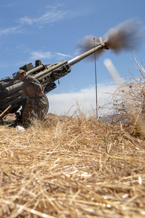 A U.S. Marine with Fox Battery, 2nd Battalion, 11th Marine Regiment, 1st Marine Division, fires an M777 howitzer during Summer Fire Exercise 19 at 62 Area on Marine Corps Base Camp Pendleton, California, July 23, 2019. The Marines are conducting Summer FIREX, a live-fire regimental-level exercise, from July 22 to Aug. 1. The exercise is designed to bring the entire regiment together and maximize the training areas available on Camp Pendleton to enhance their ability to conduct real-world operations.