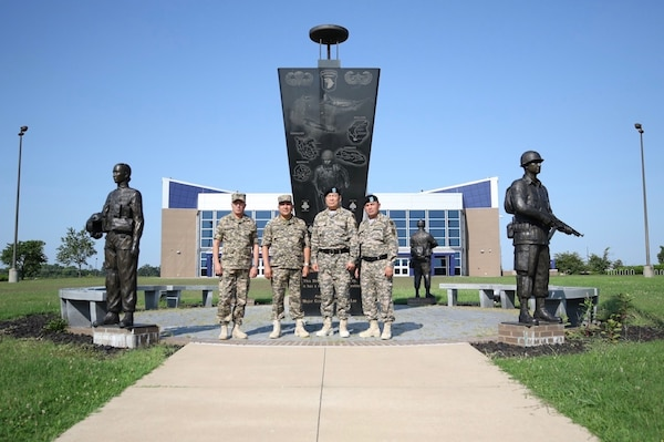 Senior leaders of the Kazakhstan Ground Forces pose in front of the 101st Airborne Division (Air Assault) headquarters Fort Campbell, Ky., 25 July.