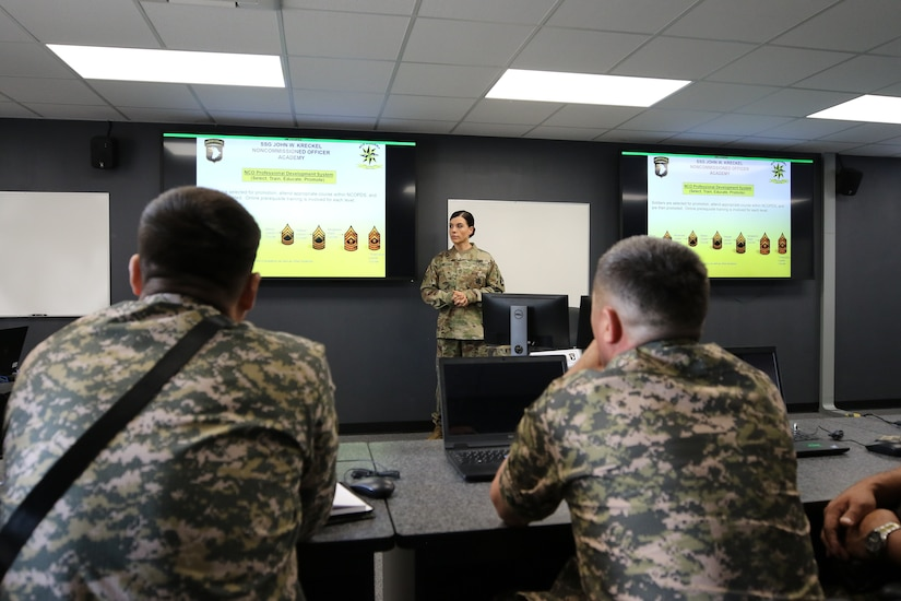 Master Sgt. Landi Whiteside, instructor at the Staff Sgt. John W. Kreckel Noncommissioned Officer Academy for the 101st Airborne Division (Air Assault) on Fort Campbell, Ky, gives a briefing on the U.S. Army's NCO Professional Development System to senior leaders of the Kazakhstan Ground Forces 25 July.