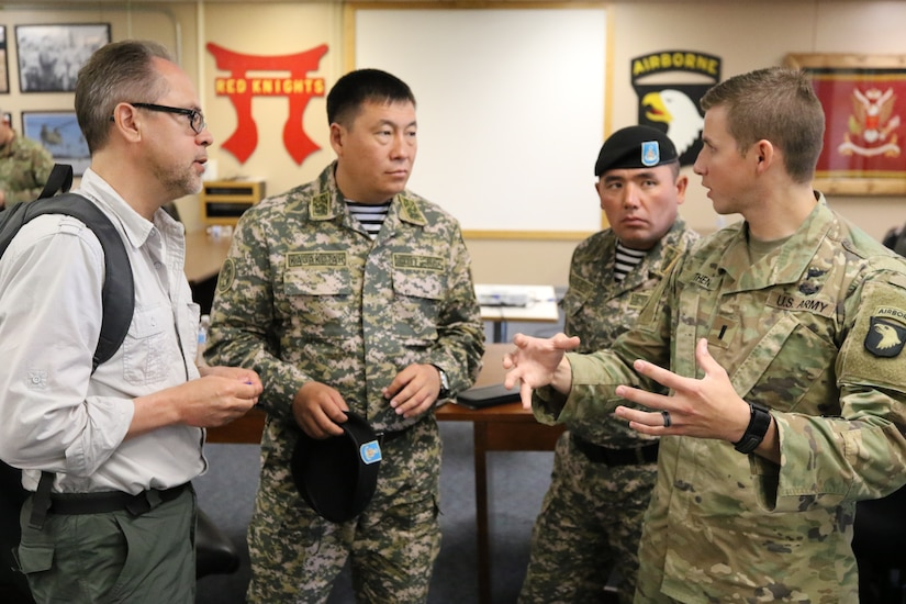 1st Lt. Benjamin Feithen, a Soldier with Headquarters and Headquarters Company, 3rd Battalion 320th Field Artillery Regiment, 3rd Brigade Combat Team, 101st Airborne Division (Air Assault), Fort Campbell, Ky., gives a one-on-one explanation of his duties to senior leaders of the Kazakhstan Ground Forces July 25. 