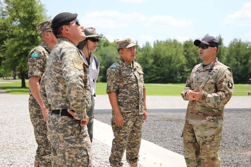 Sgt. 1st Class Marc Lawrence, Company first sergeant of The Sabalauski Air Assault School on Fort Campbell, Ky., gives a briefing on the different rappel methods thought at the Air Assault School to senior leaders of the Kazakhstan Ground Forces 25 July. 