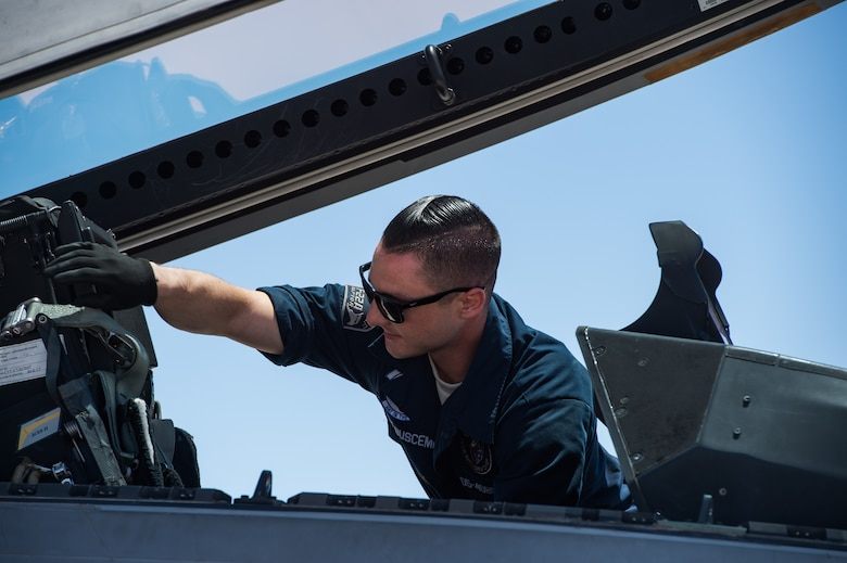 U.S. Air Force Staff Sgt. Lenny Buscemi, 94th Aircraft Maintenance Unit dedicated crew chief, prepares an F-22 Raptor before takeoff at Nellis Air Force Base, Nevada, July 18, 2019.