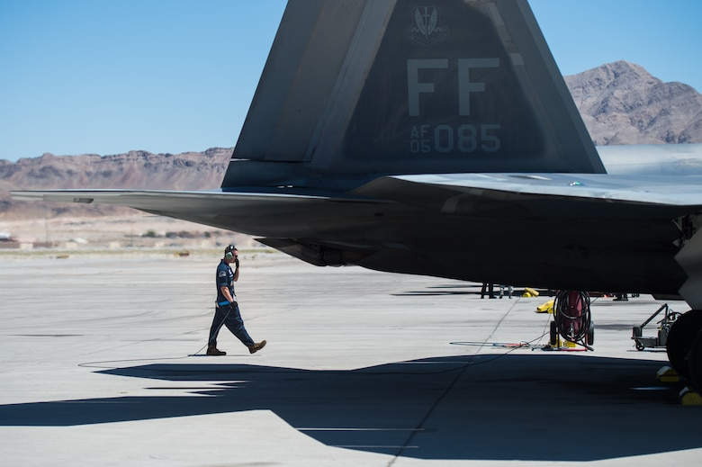 U.S. Air Force Staff Sgt. Lenny Buscemi, 94th Aircraft Maintenance Unit dedicated crew chief, runs an operations check before takeoff at Nellis Air Force Base, Nevada, July 18, 2019.