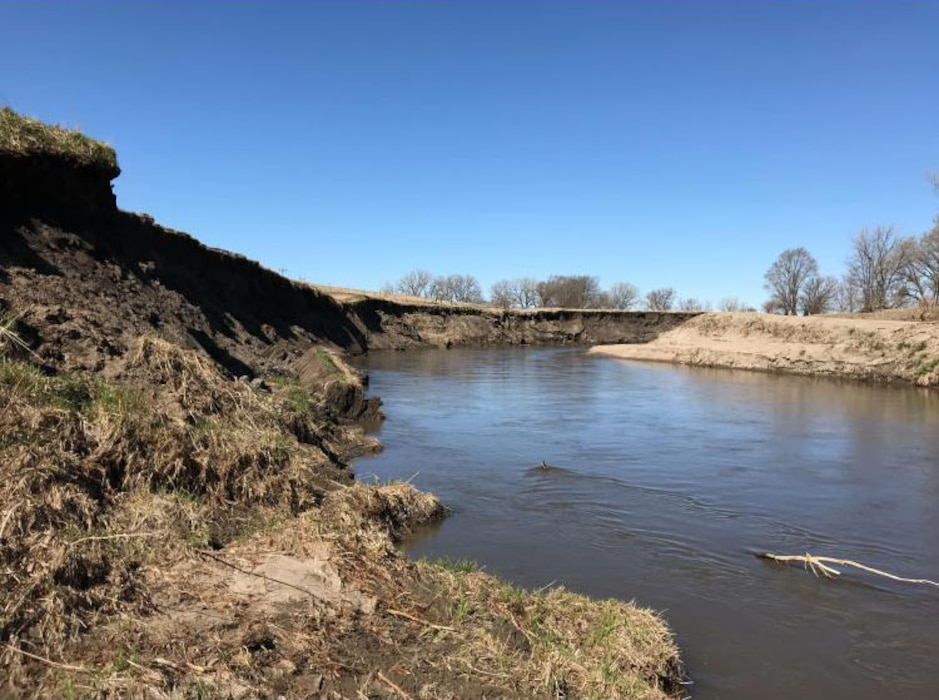 Significant erosion on lower bank ledge looking upstream. Damage identified during the initial damage assessment on Apr. 20, 2019.