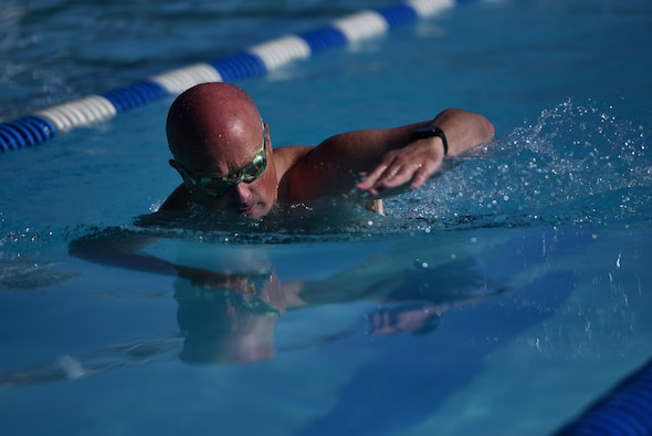 U.S. Air Force Maj. Joshua Reno, 860th Aircraft Maintenance Squadron commander, swims during the first leg of the Travis Triathlon July 27, 2019, at Travis Air Force Base, California. During the triathlon, which is in its 26th year, 31 athletes competed against one another. Participants had to swim 400 meters, bike 12 miles and run 3.1 miles. (U.S. Air Force Photo by Airman 1st Class Cameron Otte)