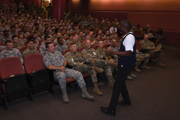 Retired U.S. Air Force Chief Master Sgt. Juan Lewis, the (Fired up Chief), speaks with Airmen July 26, 2019, at Travis Air Force Base, California. Lewis spoke with Airmen about the importance of having passion, enthusiasm and pride, something that has guided his 28-year military career. In retirement, Lewis travels to bases across the United States to share his experiences with Airmen. (U.S. Air Force photo by Airman 1st Class Cameron Otte)