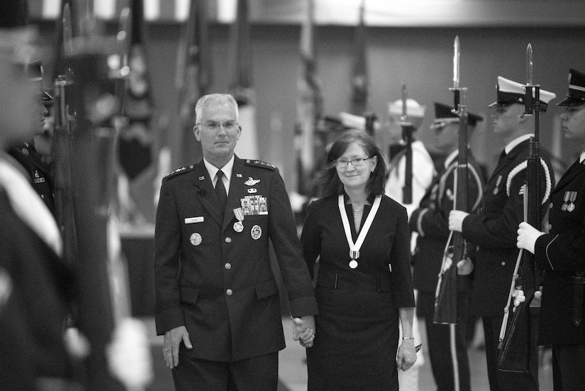 Gen. Paul Selva and his wife, Ricki, hold hands.