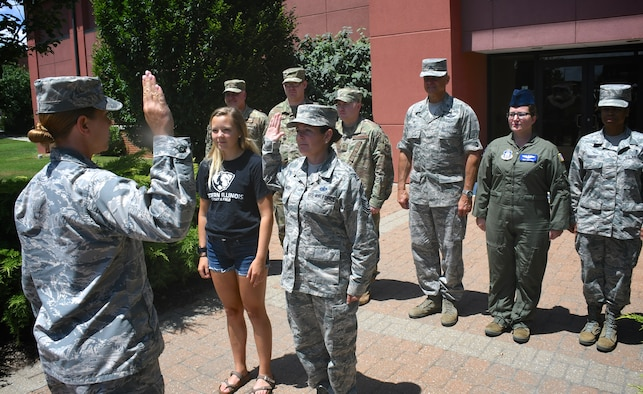 The highest ranking enlisted member of the 932nd Airlift Wing, Command Chief Master Sgt. Barbara Gilmore (third from left), reenlists with the oath performed by 1st Lt. Sheri Mason-Rogier, 932nd Mission Support Group executive officer, on July 14, 2019, at Scott Air Force Base, Ill.  (U.S. Air Force photo by Lt. Col. Stan Paregien)